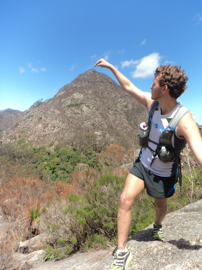 Ben Duffus Points to Mt Barney West Peak